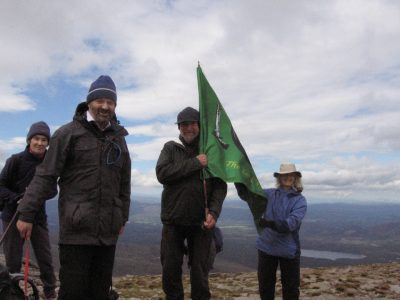Unfurliing the banner at the summit of Cairngorm